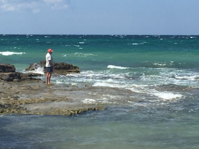 Richard at Pilone Spiaggia, a beautiful sand beach with perilous rocks