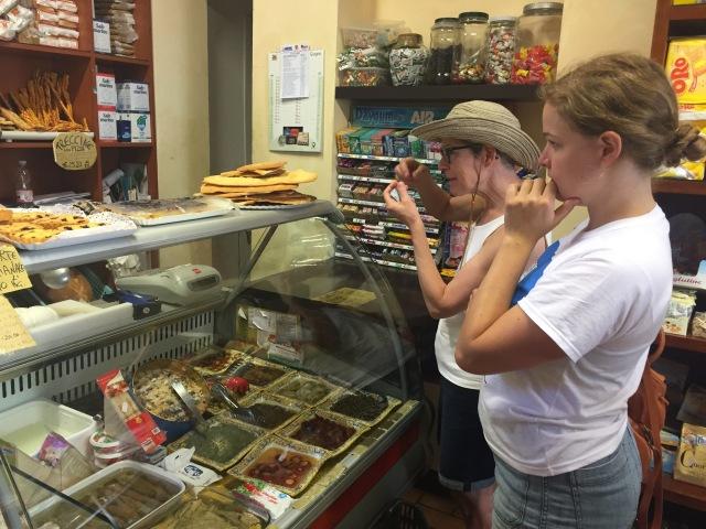 Sandra speaks true Italian (hand gestures)  while buying picnic food at favorite alimentari.