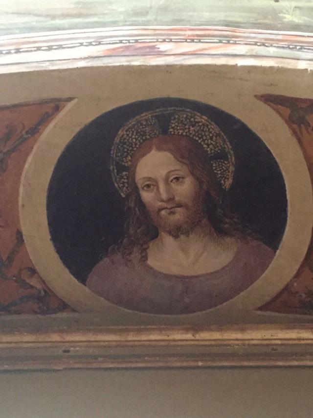 Beautiful fresco of Jesus over the door