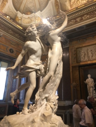 Apollo pursues Daphne, who's turning into a tree